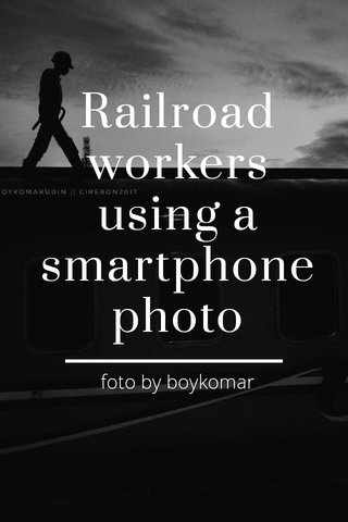 Railroad workers using a smartphone photo foto by boykomar