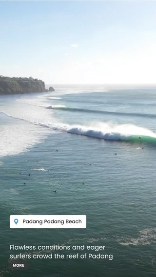 Flawless conditions and eager surfers crowd the reef of Padang Padang, Bali