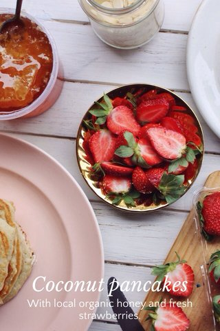 Coconut pancakes With local organic honey and fresh strawberries.